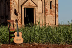 Classical acoustic guitar in ruins of abandoned church Stock Photography