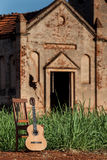 Classical acoustic guitar in ruins of abandoned church Royalty Free Stock Photography