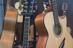 Classical acoustic guitars in musical store. Music Royalty Free Stock Photo