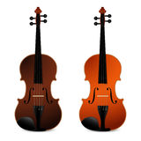 Classical acoustic violins on black background. Music instrument. Royalty Free Stock Image