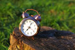 Classical alarm clock stand on stub Royalty Free Stock Image