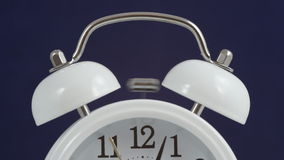 A classical analog alarm clock ringing stock footage