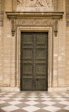 Classical antic door - closed. Huge classical antic door made of metal with many ornaments Royalty Free Stock Images