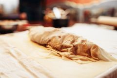 Classical apple strudel prepared for baking. Closeup, nobody. Homemade sweet dessert, cooking recipe Stock Images