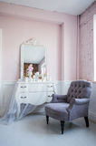 Classical armchair and mirror table at living room interior stock photos