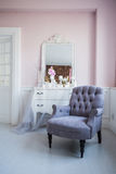 Classical armchair and mirror table at living room interior royalty free stock photo