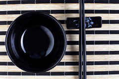 Classical asian chopsticks and black bowl Stock Images