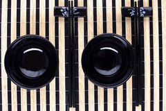 Classical asian chopsticks and bowls Stock Photos