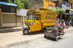The classical auto rickshaw is the unique vehicle style of local transportation in several Asian countries. PONDICHERY, PUDUCHERRY, TAMIL NADU, INDIA - SEPTEMBER stock photography