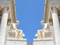 Classical background. Beautiful classical theme with white marble Greek statues and columns against blue sky Royalty Free Stock Image