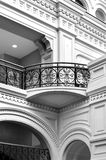 Classical balcony. Balcony in classicism style of eighteenth century with curved arch and forged fence, architectural element in monochrome Stock Photography