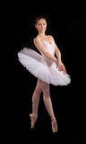 Classical ballerina in a white skirt Stock Image