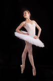 Classical ballerina in a white skirt stock photos
