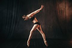 Classical ballet dancer in black practice training Royalty Free Stock Photo