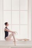 Classical Ballet dancer portrait at window background Stock Photos