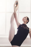 Classical Ballet dancer in split stretching, portrait Royalty Free Stock Images