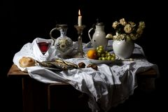 Classical Baroque Still-life in Dutch breakfast style on a black Background. Displaying vanitas and mortality Stock Images