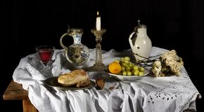 Classical Baroque Still-life in Dutch breakfast style on a black Background stock photography