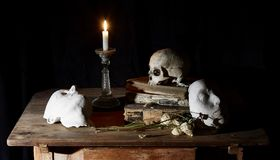 Classical Baroque Still-life in Vantias style with Skull and Death-Mask on a black Background. Classical Baroque Still-life in Vanitas style with Skull and Death Stock Image
