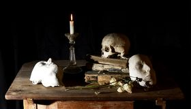 Classical Baroque Still-life in Vantias style with Skull and Death-Mask on a black Background. Classical Baroque Still-life in Vanitas style with Skull and Death Stock Photos