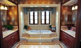 Classical bathroom. Marble bathtub. flower wallpaper.Classical design.big mirrior Stock Images