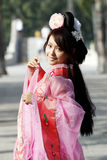 Classical beauty in China. A girl in Chinese ancient dress. She wave pleasant posture Stock Photo