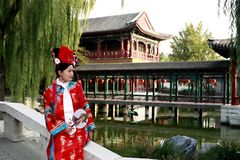 Classical beauty in China. A beautiful girl in Chinese ancient dress is in the royal garden Stock Images
