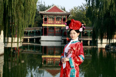 Classical beauty in China. A beautiful girl in Chinese ancient dress is in the royal garden Royalty Free Stock Photos