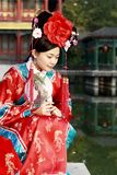 Classical beauty in China. A beautiful girl in Chinese ancient dress is in the royal garden Stock Photo
