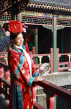 Classical beauty in China. A girl in Chinese ancient dress stands in the attic in the royal garden Royalty Free Stock Image