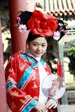 Classical beauty in China. A beautiful girl in Chinese ancient dress is in the royal garden Stock Photography