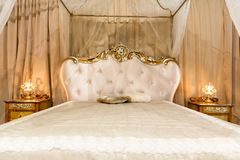 Classical bed. In a contemporary setting stock photography