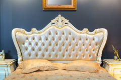 Classical bed. In typical contemporary setting royalty free stock photography