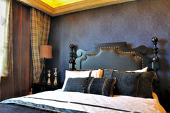 Classical bedroom in deep color. Bedroom in featured deep blue decoration, in noble style and fine furniture, shown as luxury, classical, and comfortable living Royalty Free Stock Image