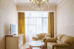 Classical bedroom with a large double bed, bedside tables, chairs Stock Images
