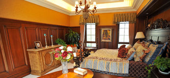 Classical Bedroom with wooden decoration Royalty Free Stock Images
