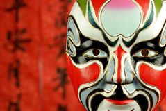 Classical beijing opera mask on festive background Stock Images