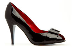 Classical black female shoe with a buckle Stock Photos