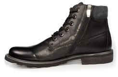 Classical black leather mans boot Royalty Free Stock Images