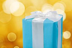 Classical blue gift box with white ribbon and bow Royalty Free Stock Image