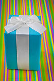 Classical  blue gift box with white ribbon and bow on stripped c Stock Photo