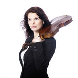 Classical brunette beauty in suit holds violin on shoulder in st Stock Photos