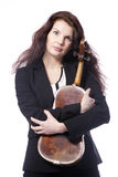 Classical brunette beauty in suit holds violin in studio Stock Photography