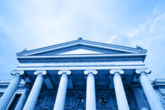 Classical building. Blue image with a classical building Royalty Free Stock Images