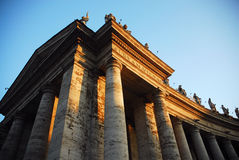 Classical building facade. With massive columns and rooftop statues royalty free stock photography