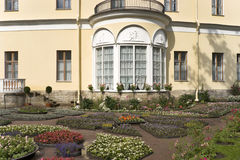 Classical building with a flower garden Royalty Free Stock Images