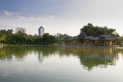 Classical building and lake. Chinese garden,wooden pavilion, lake Stock Photos