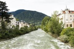 Classical building at riverside of Passer river at Meran or Merano city in Italy. View cityscape and landscape with Classical building with flowing and motion of royalty free stock photo