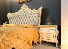 Classical buttoned bed. In typical contemporary setting Royalty Free Stock Images