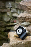 Classical camera on rocks Stock Photos